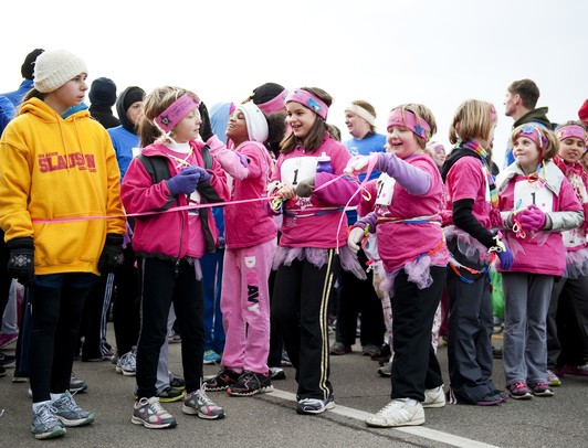 Young girls line up at the start of the Girls on the Run 5k in Ypsilanti on Sunday.